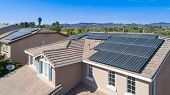 Solar Panels Installed on Roof of Large House poster