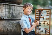 Boy With Large Abacus poster