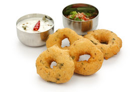 foto of urad  - vada is donut, made with urad dal flour, indian snack food