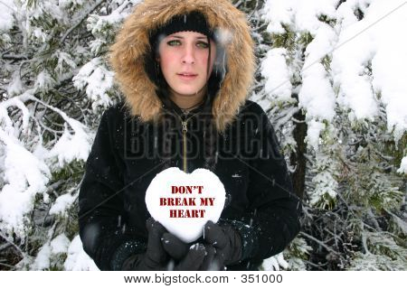 Sad Girl Holding Heart Of Snow