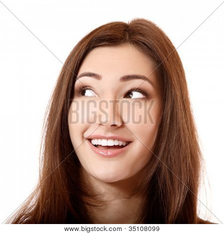 beautiful smiling girl looking up to the left corner, isolated on white