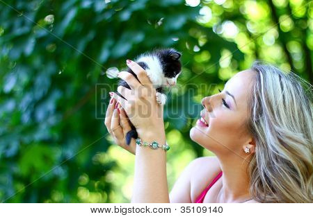 Blonde Girl With Kitten