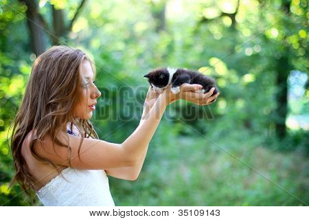 Pretty Young Caucasian Girl  With Cute Kitten