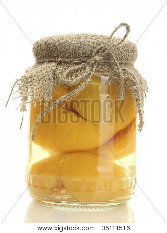 canned apricots in a jar  isolated on white