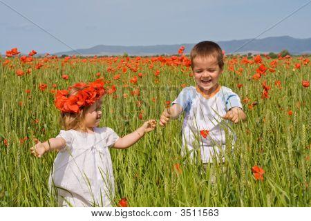 Kids On Poppy Field