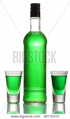 bottle and two glasses of absinthe isolated on white