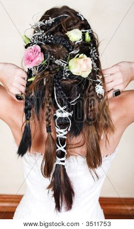 Bride With Braids And Roses