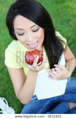 Pretty Girl Eating Apple And Reading