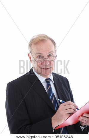 Attentive Businessman Taking Notes