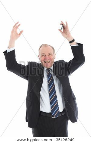 Jubilant Businessman With Arms Raised