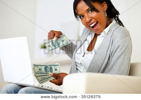 Surprised Woman With Dollars Looking To You