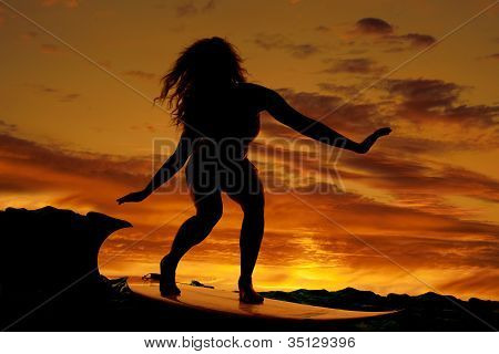 Woman Surfing Sunset