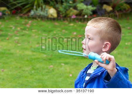 Boy Blowing Bubbles