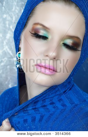 Woman In Blue And Long Eyelashes
