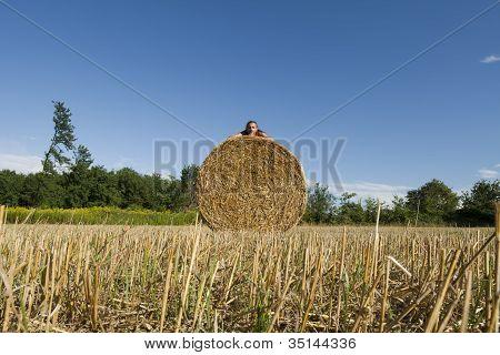 Man Lying On A Hay Bales