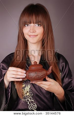 Tea Ceremony Happy Woman With Teapot On Hands