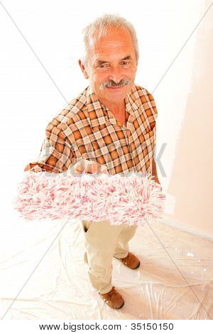 Senior Man With Paint Roller