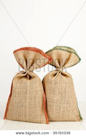 Two Jute Bags On A White Table