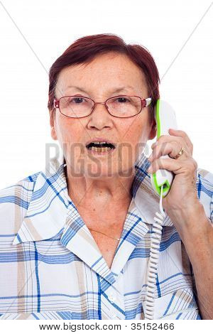 Shocked Senior Woman On The Phone