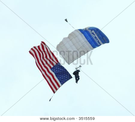 Skydiver With Us Flag In Airshow