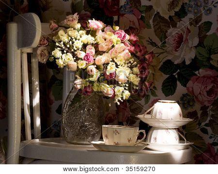 Vintage elegant cups and flowers in the vase
