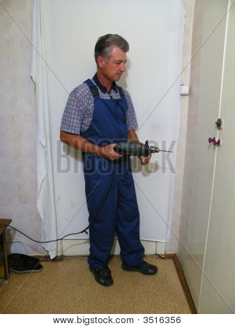 Standing Worker With Punch Machine In Room 2