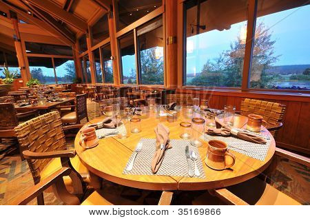 Dinning Room With Tables, Chairs And Fireplace