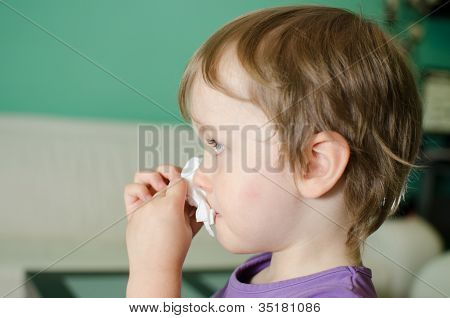Boy Cleaning His Nose