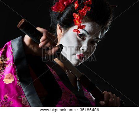Portrait Of Geisha Pulls Out Sword Of Sheath On Black