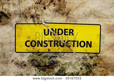 under construction broken sign
