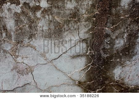 Old Mossy Stone Wall With Cracks