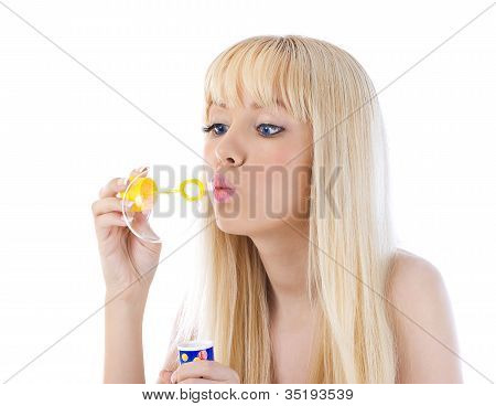 Portrait Of A Beautiful Young Woman Blowing Bubble