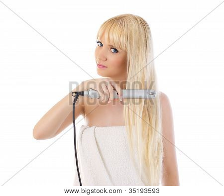 Woman Using Hair Straighteners