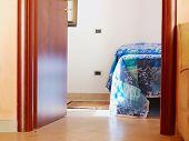picture of open door  - View on a very simple bedroom and open door - JPG