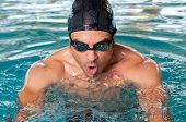 picture of breast-stroke  - Healthy man swimming with effort at swimmingpool - JPG