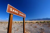 pic of mesquite  - Sign in Death Valley National Park pointing out location of the Mesquite Flat Sand Dunes for visitors - JPG