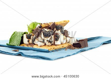 S'more On Plate With Chocolate And Marshmellows