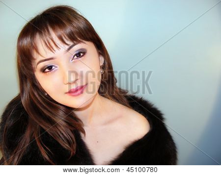 portrait of the girl in fur coat
