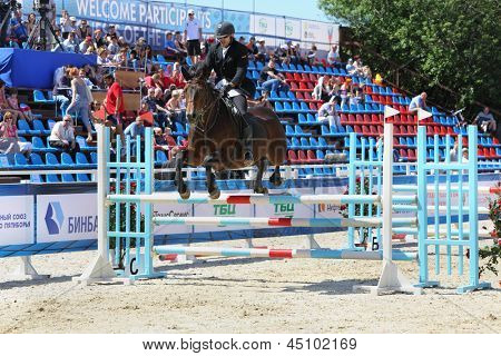 MOSCOW - JUN 17: Man participate in horse competitions on tournament on modern pentathlon - Kremlin Cup in horse-racing centre of CSKA, on Jun 17, 2012 in Moscow, Russia.