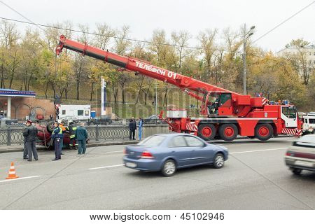 MOSCOW - OCT 9: Large red rescue vehicle helps injured in car crash on October 9, 2011 in Moscow, Russia.