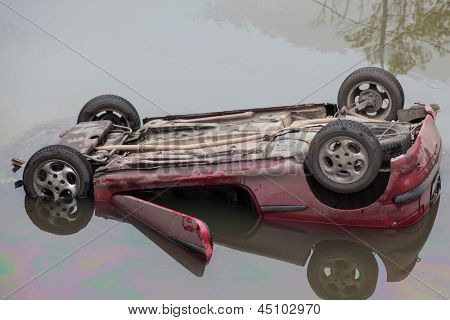 MOSCOW - OCT 9: The red Peugeot 206 fell into the river Yauza and capsized on October 9, 2011 in Moscow, Russia.