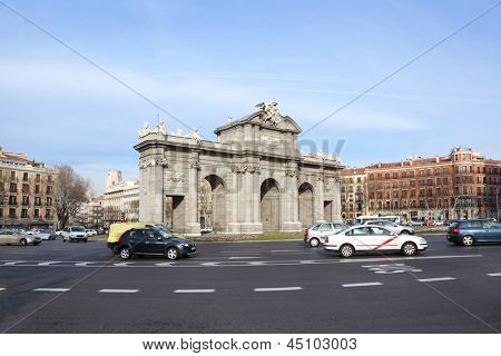 MADRID - MARCH 8: Arch Puerta de Alcala at Independence of Spain square, on March 8 2012 in Madrid, Spain. Spain is the second largest in the world by the number of steps it has tourists and visitors.