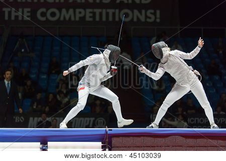 MOSCOW - APR 6: Serious clash on championship of world in fencing among juniors and cadets, in Sports Olympic complex, on April 6, 2012 in Moscow, Russia