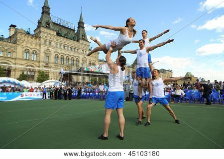 MOSCOW - MAY 26: Circus artists make difficult tricks on the court Dynamo on VIII Forum Ready for Labor and Defense on May 26, 2012 in Red Square, Moscow, Russia.