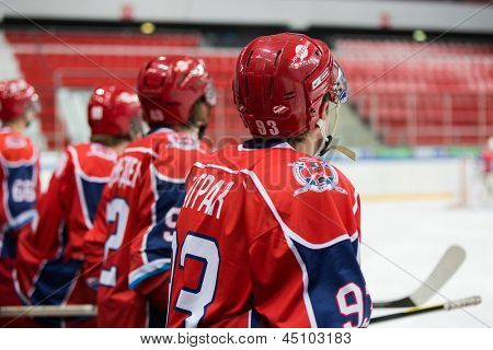 MOSCOW - APR 28: Rear view of the players on closing ceremony of the championship season of 2011-2012 Ice Hockey for Sports School, junior teams on April 28, 2012  in Sokolniki, Moscow, Russia.