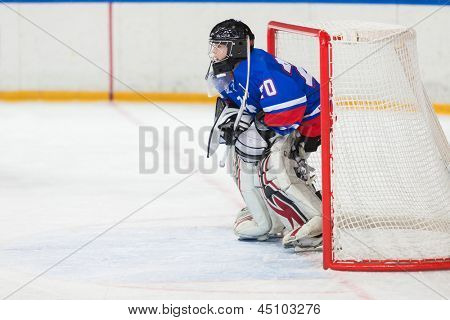 MOSCOW - APR 28: Goalkeeper is on the gate on closing ceremony of the championship season of 2011-2012 Ice Hockey for Sports School, junior teams on April 28, 2012  in Sokolniki, Moscow, Russia.