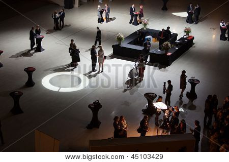 MOSCOW - APR 12: People go on hall and communicate in twilight after Ceremony of rewarding of winners of an award Brand of year of EFFIE 2011, on April 12, 2012 in Moscow, Russia