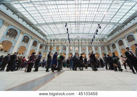 MOSCOW - APR 12: People go in Gostini dvor before Ceremony of rewarding of winners of an award Brand of year of EFFIE 2011, on April 12, 2012 in Moscow, Russia