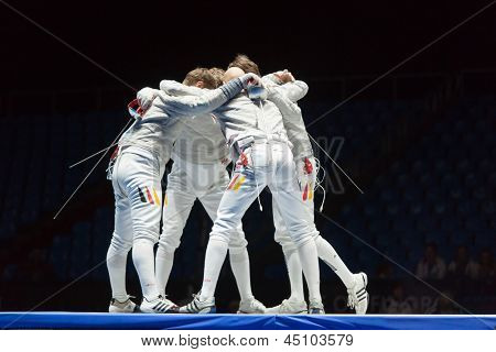 MOSCOW - APR 6: Athletes embrace in competitions on championship of world in fencing among juniors and cadets, in Sports Olympic complex, on April 6, 2012 in Moscow, Russia