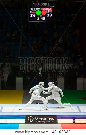 MOSCOW - APR 6: Trushakov and Karabinski compete  on championship of world in fencing among juniors and cadets, in Sports Olympic complex, on April 6, 2012 in Moscow, Russia